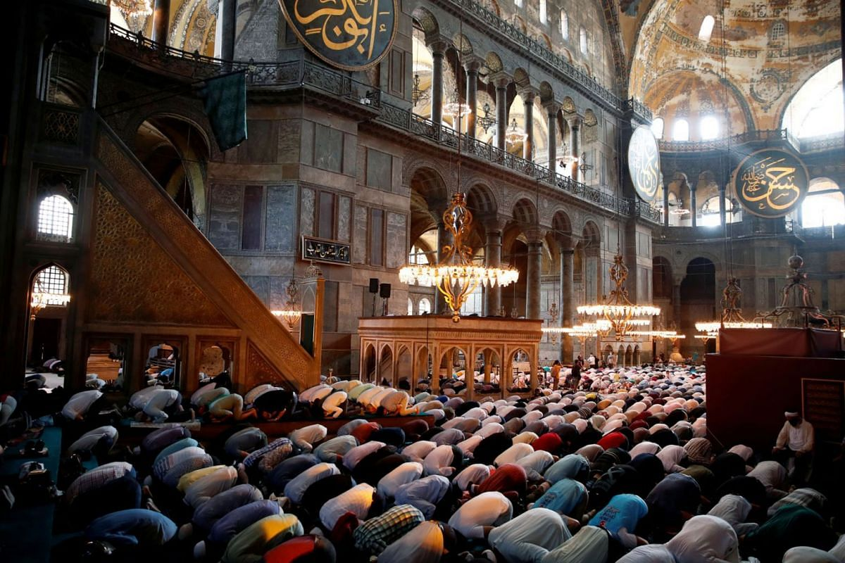 Worshippers attend afternoon prayers and visit Hagia Sophia Grand Mosque, for the first time after it was once again declared a mosque after 86 years, in Istanbul, Turkey, July 24, 2020. PHOTO: REUTERS