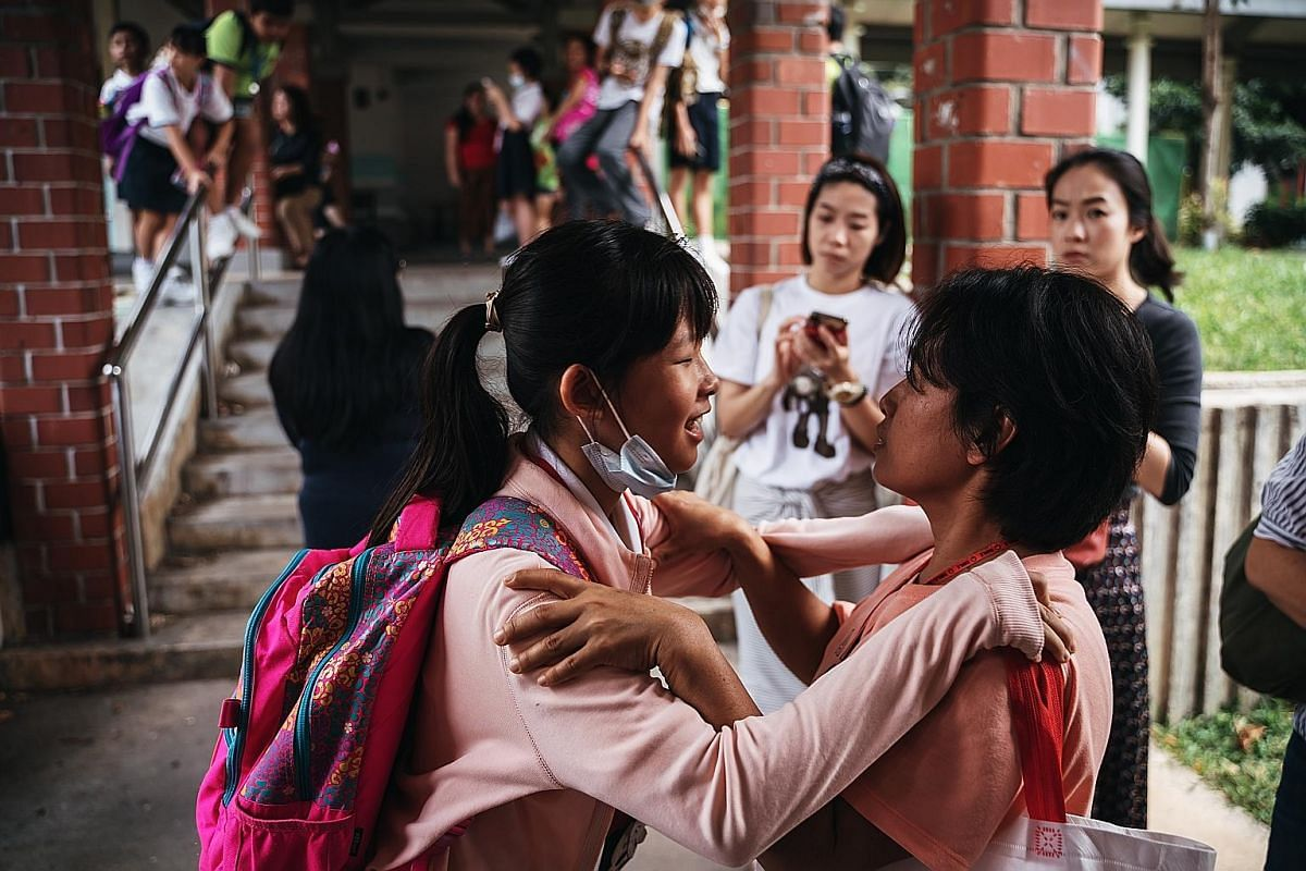 Right: Although both Yan Yun and her sister Yan Ling, 11, go home from school together, they tend to separate from each other on the bus or the train. For example, on a double-decker bus, one would sit on the upper deck while the other would sit on t