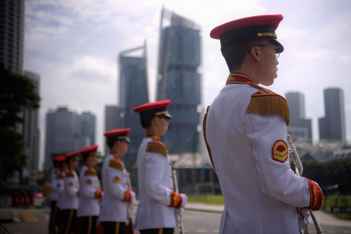 The marching contingent from the combined band consisting members of the SPF and SAF during NDP rehearsal at the Padang on July 26, 2020.