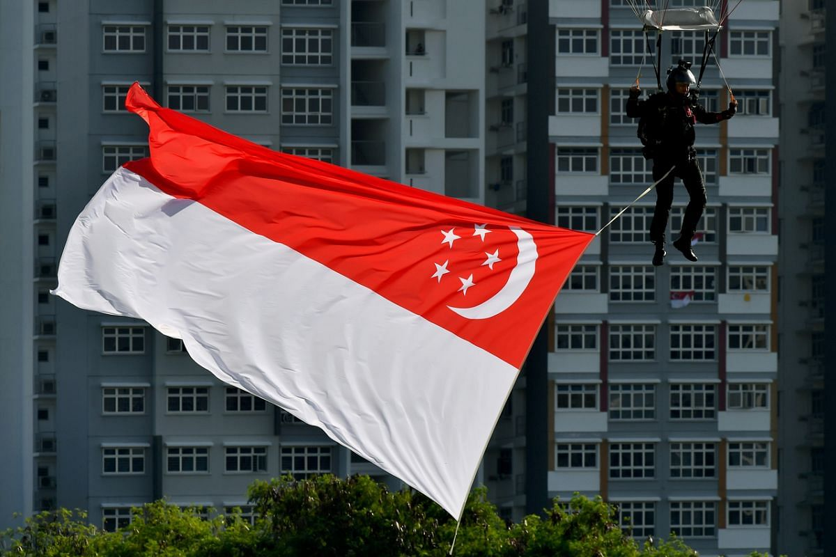 A member of the Red Lions landing at the open field near Sengkang General Hospital during the NDP rehearsal on July 26, 2020.