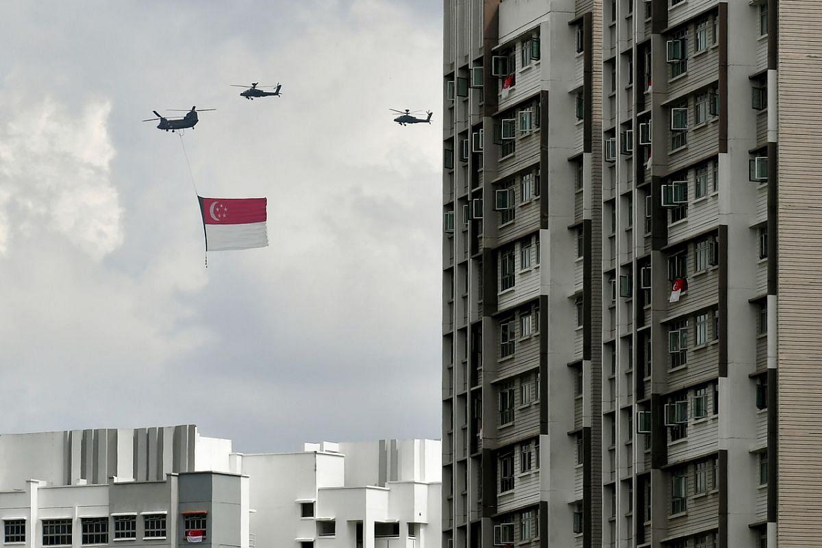 State flag flypast above flats along Sengkang East Way near Sengkang General Hospital during during the NDP rehearsal on July 26, 2020.