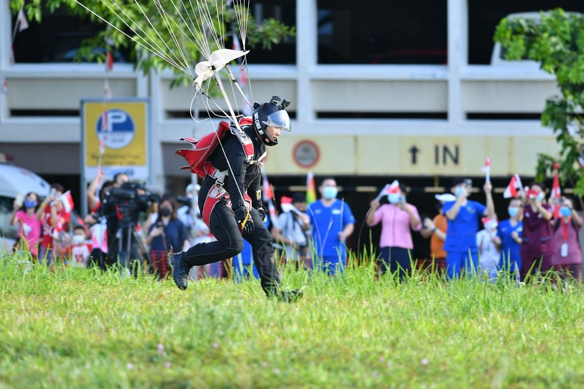 The Red Lions land at the grass patch near Block 285C Toh Guan Road during the NDP rehearsal on July 26, 2020.