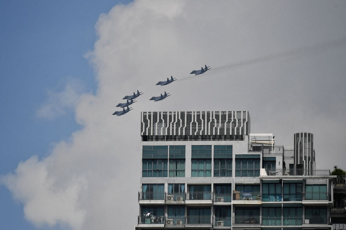 F-15SG fighter jets flying over the J Gateway condo in Jurong during the NDP rehearsal on July 26, 2020.