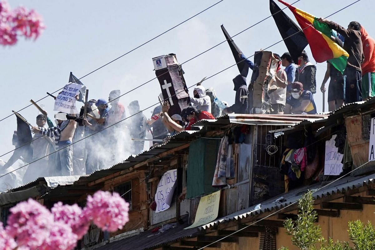 Inmates protest on the rooftop of the San Sebastian prison, to demand government medical assistance, amid the coronavirus disease outbreak, in Cochabamba, Bolivia, July 27, 2020. PHOTO: REUTERS