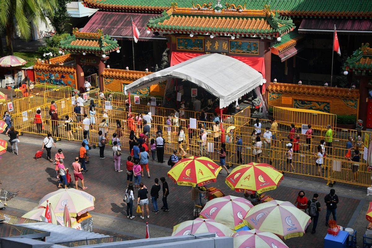 Worshippers observing safe distancing measures as they queue at the Kwan Im Thong Hood Cho Temple in Waterloo Street on July 27, 2020.