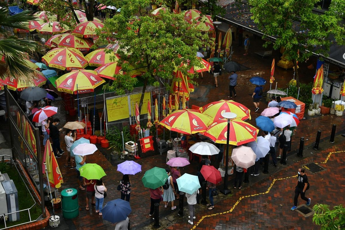 Long snaking queues outside the Kwan Im Thong Hood Cho Temple in Waterloo Street on July 27, 2020.