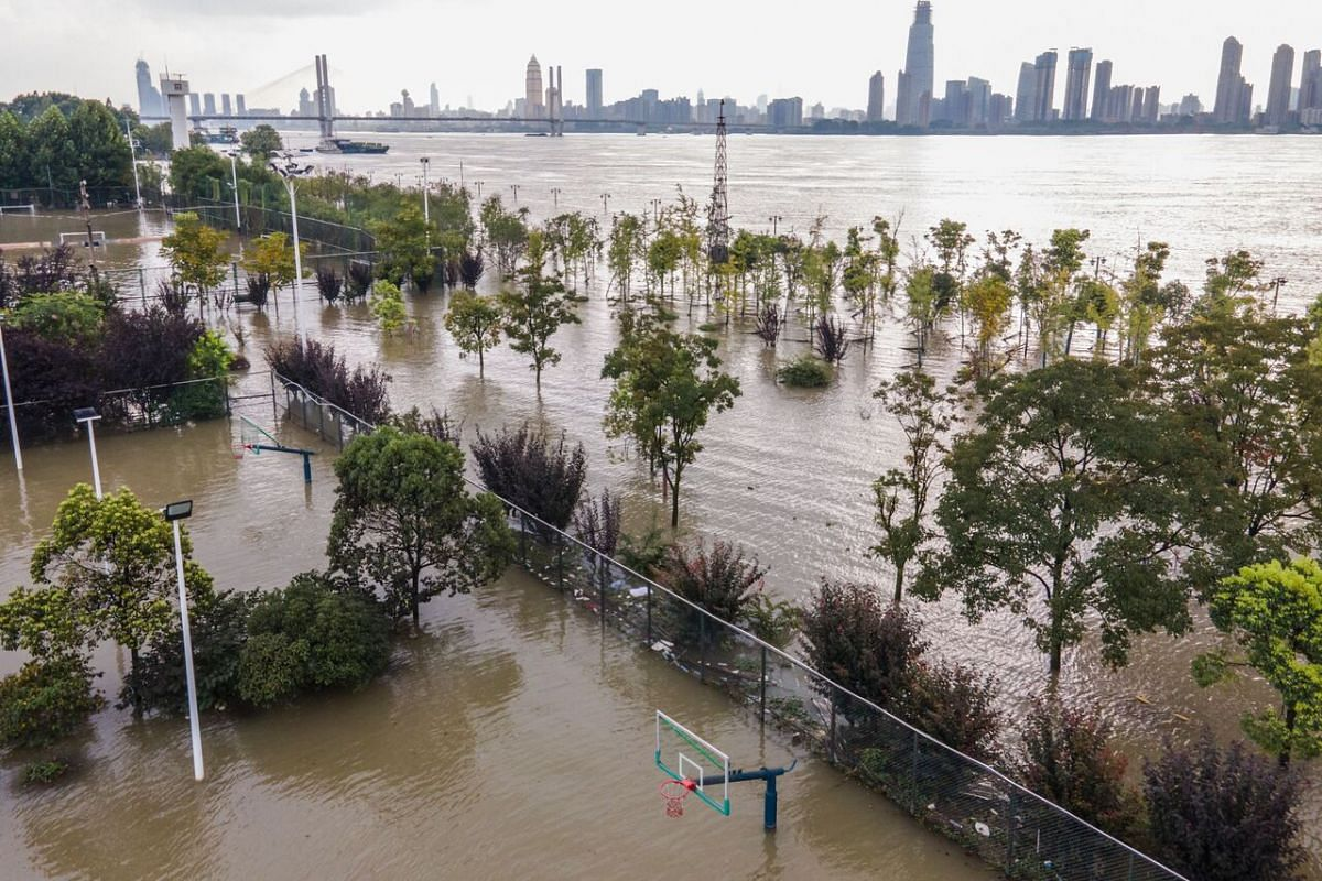 An aerial photo taken on July 28, 2020, shows a flooded sports ground by the Yangtze River in Wuhan in China's central Hubei province.