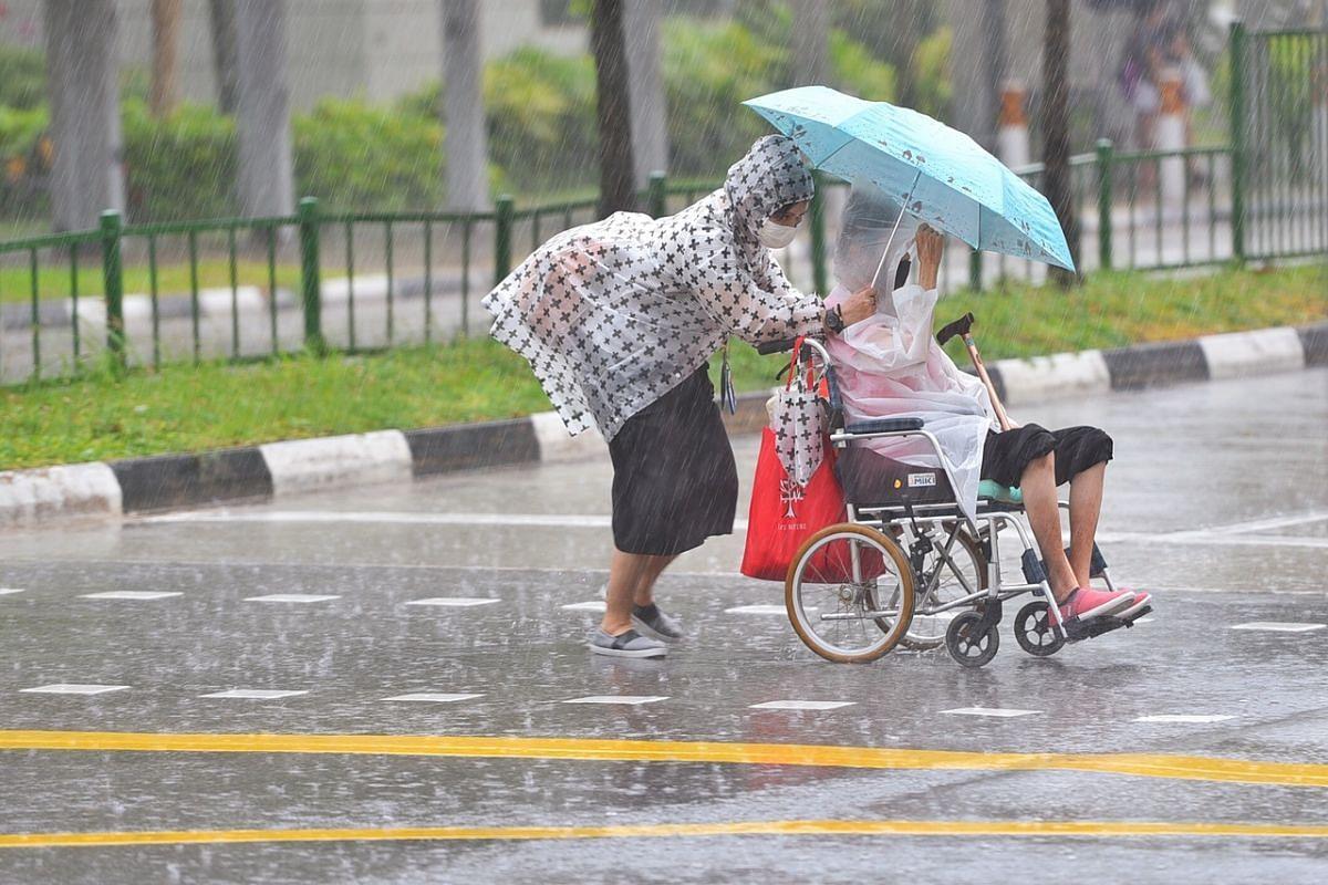 Pedestrians crossing Old Airport Road near Singapore's Dakota MRT station on July 26, 2020.