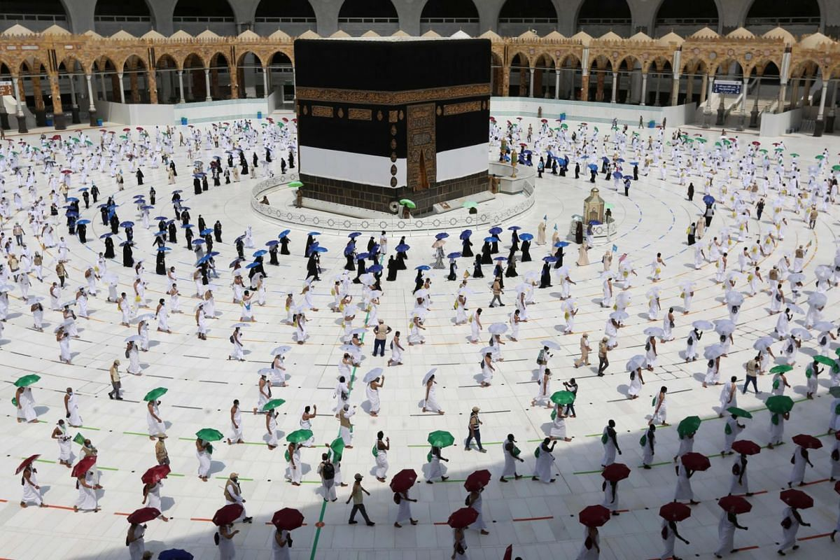 A picture taken on July 29, 2020 shows pilgrims circumambulating around the Kaaba, Islam's holiest shrine, at the centre of the Grand Mosque in the holy city of Mecca, at the start of the annual Muslim Hajj pilgrimage. PHOTO: AFP