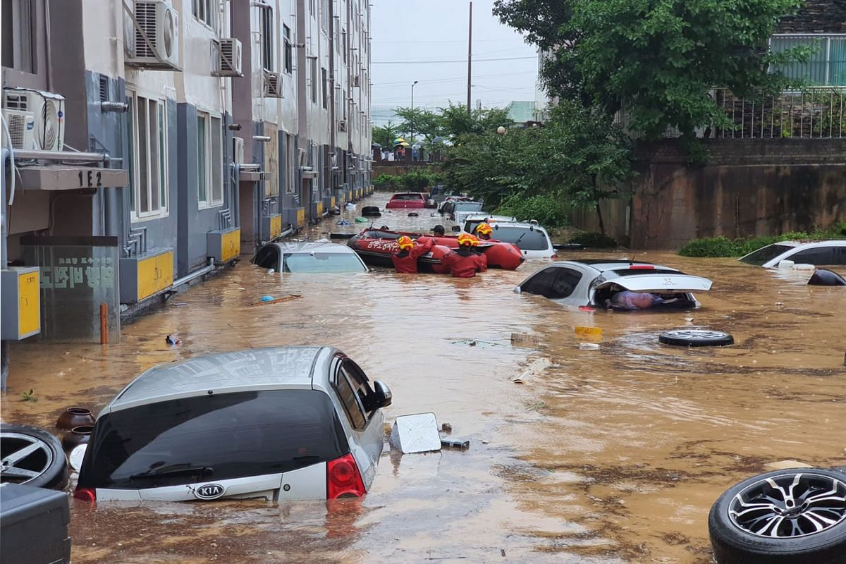 Flood inundates a parking lot of an apartment complex after torrential rains in Daejeon, South Korea on July 30,  2020. PHOTO: YONHAP VIA EPA-EFE