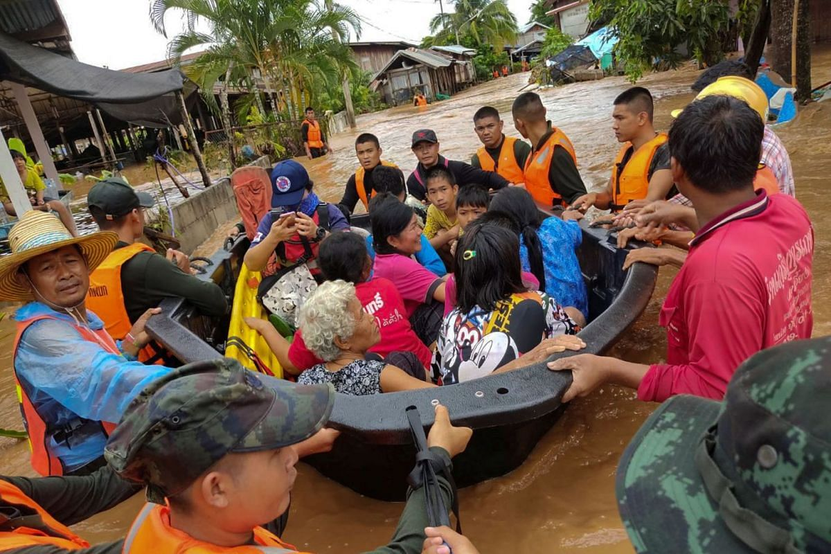 Soldiers evacuate villagers affected by heavy rain at Muang district in Loei province, Thailand, August 2, 2020. Picture taken August 2, 2020. PHOTO: ROYAL THAI ARMY VIA REUTERS
