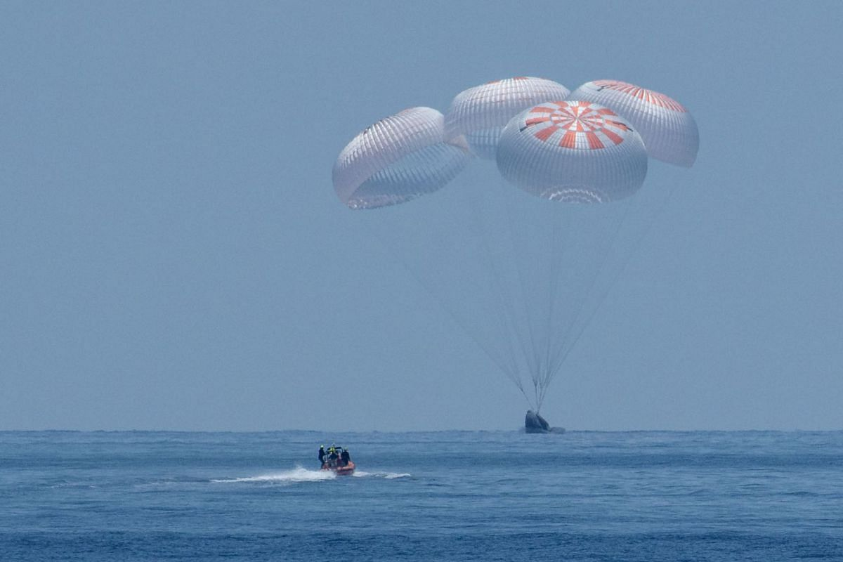 The SpaceX Crew Dragon Endeavour spacecraft is seen as it lands with NASA astronauts Robert Behnken and Douglas Hurley onboard in the Gulf of Mexico off the coast of Pensacola, Florida, U.S., August 2, 2020. PHOTO: NASA VIA REUTERS