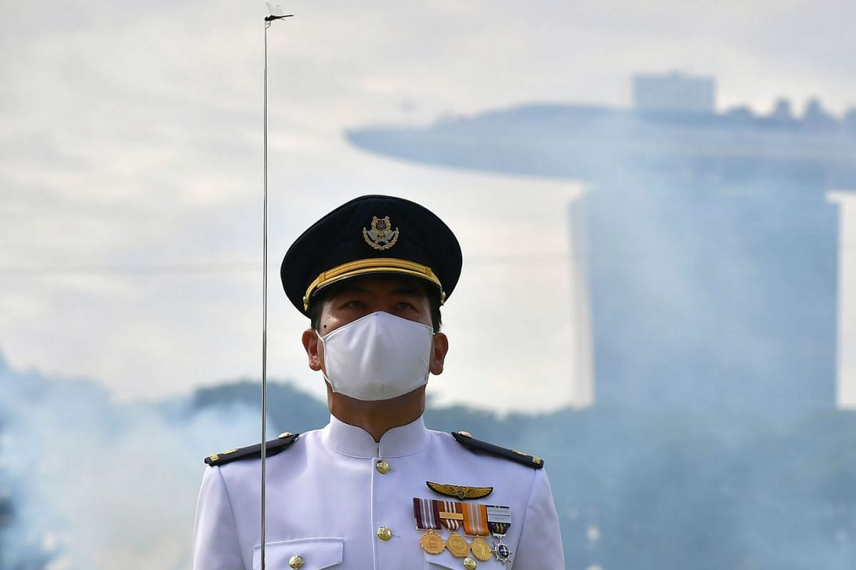 A dragonfly  is seen on the tip of a sword held by MAJ Aaron Tan, Contingent Commander for RSAF guest-of-honour during the National Day Parade 2020 rehearsal at the Padang on August 1, 2020. PHOTO: THE STRAITS TIMES/NG SOR LUAN
