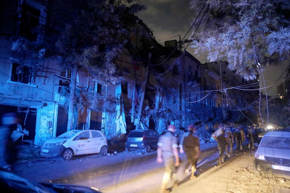 Lebanese army commandos deploy in the partially destroyed trendy neighbourhood of Mar Mikhael following an explosion at the port of Beirut on Aug 4, 2020.