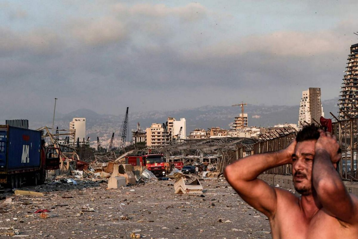 A man reacts at the scene of an explosion at the port in Beirut on Aug 4, 2020.