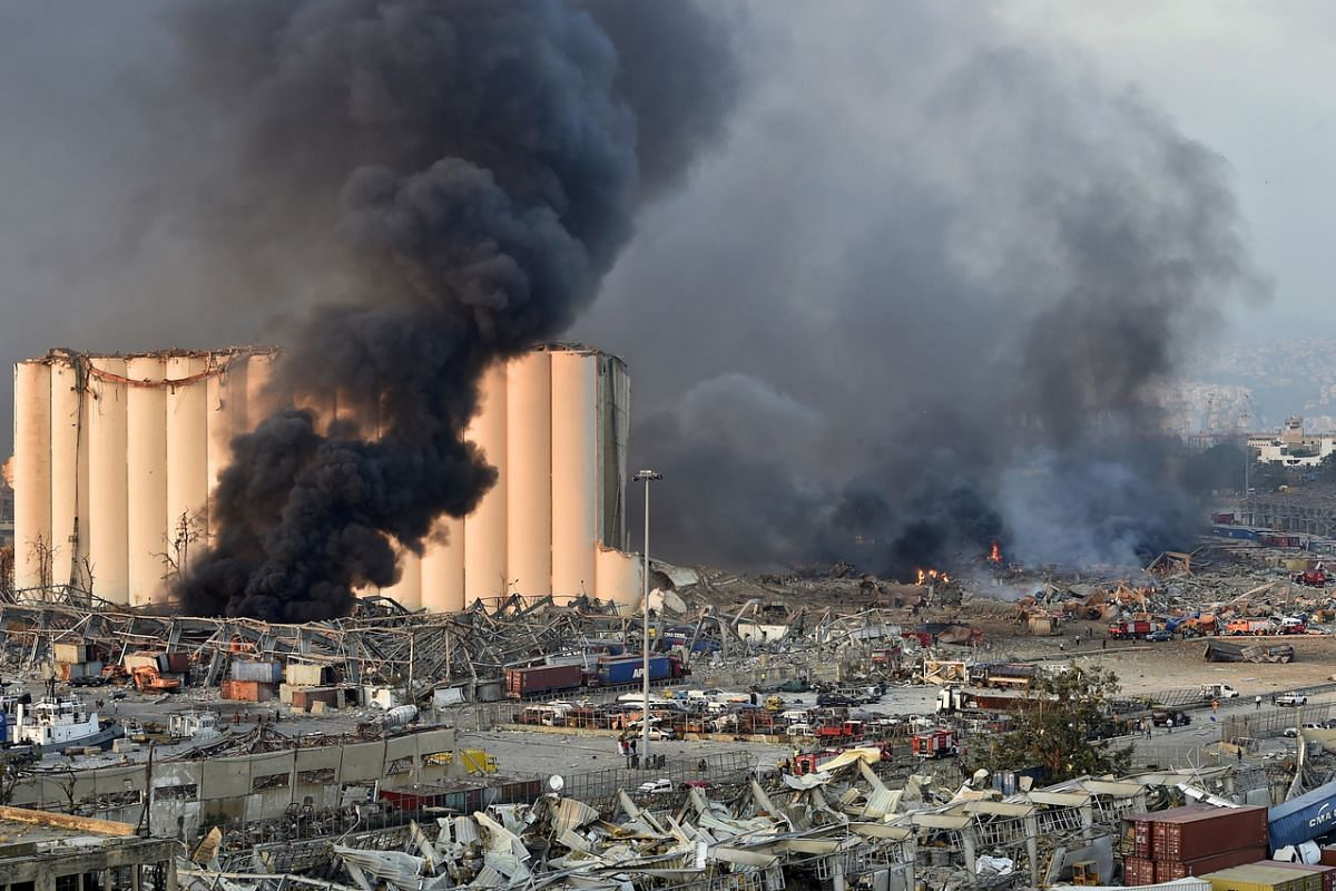 Smoke billows from the harbour area with damage and debris after a large explosion rocked the harbour of Beirut on Aug 4, 2020.