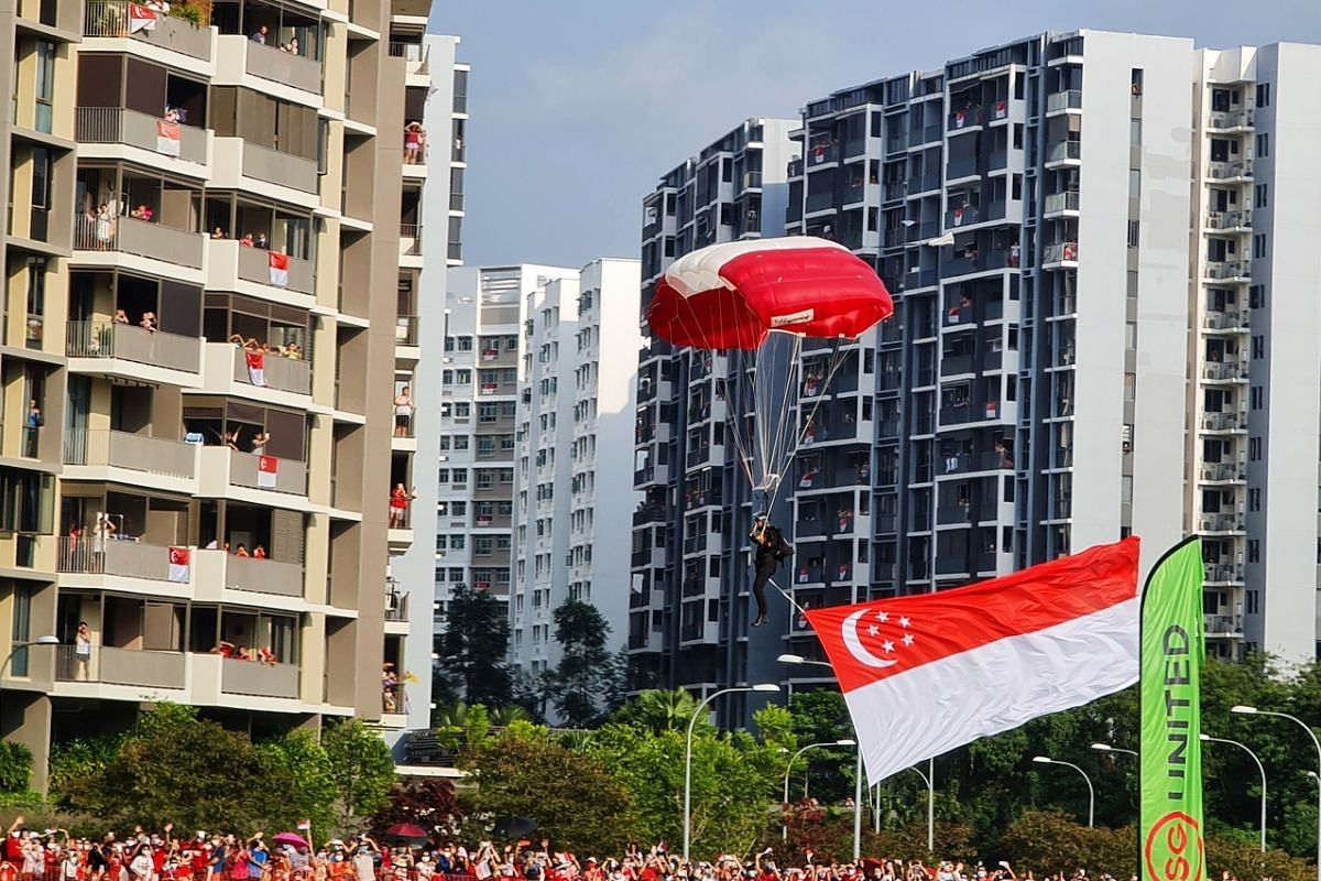 A member of the Red Lions team whizzes through the air amid cheers from the crowd near Sengkang General Hospital. This photo was captured on the Samsung Galaxy Note20 Ultra 5G with 5x optical zoom and laser autofocus.