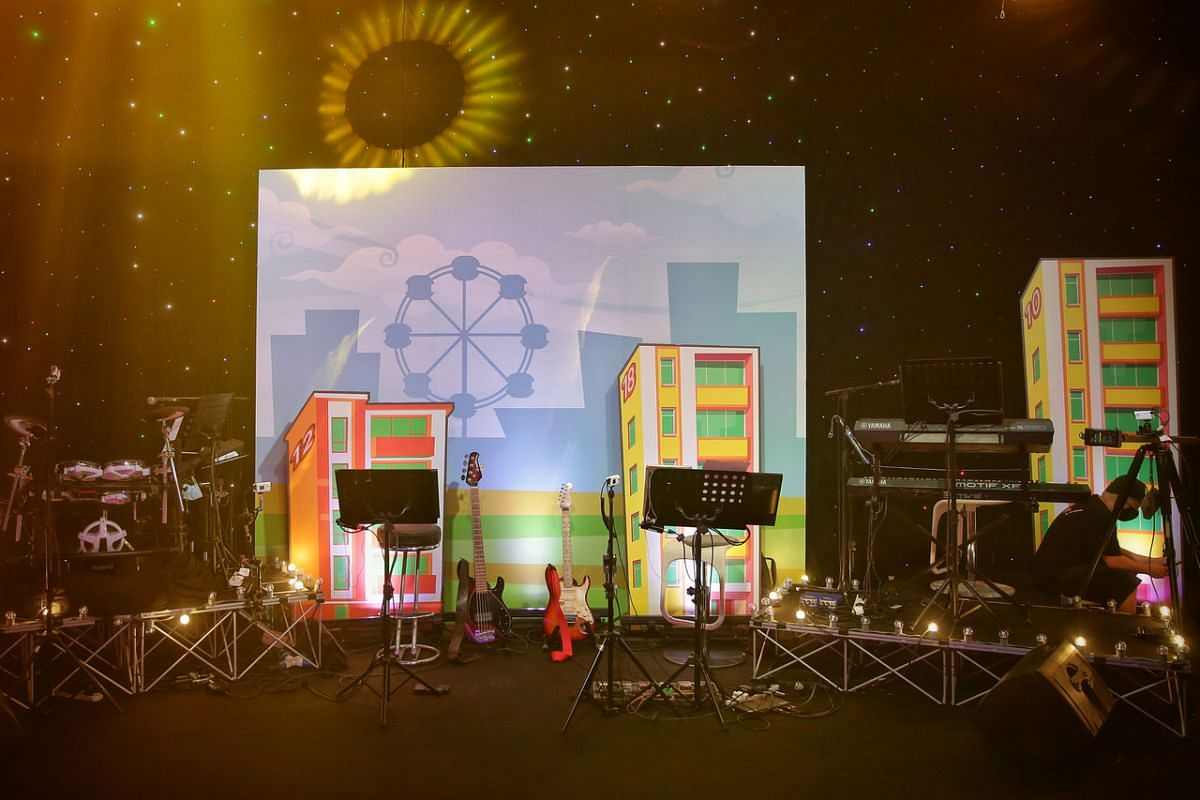 A backdrop of HDB blocks and cityscape form part of the set at an online getai show.