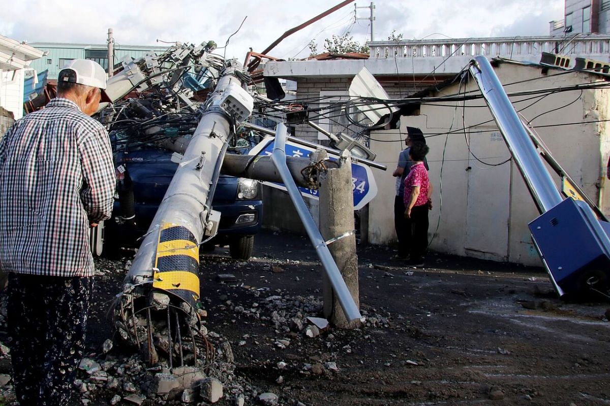 An electric pole downed by Typhoon Maysak in the south-eastern port city of Ulsan, South Korea, on Sept 3, 2020.