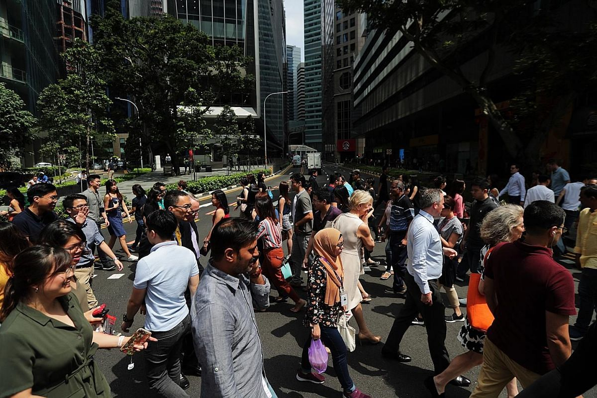 The lunch crowd in the CBD in January. For a nation that needs to be a global city to remain relevant, and also a home for Singaporeans, the balance between foreign professionals and the Singaporean core will perhaps always be tough to strike.