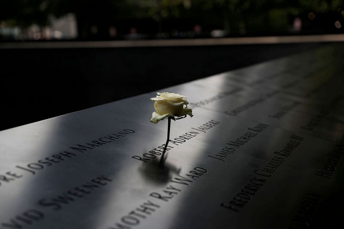 A rose is placed on one of the victims' names at the south reflecting pool of the National 9/11 Memorial, two days before the 19th anniversary of attacks, in the lower section Manhattan, New York City, U.S., September 9, 2020. PHOTO: REUTERS