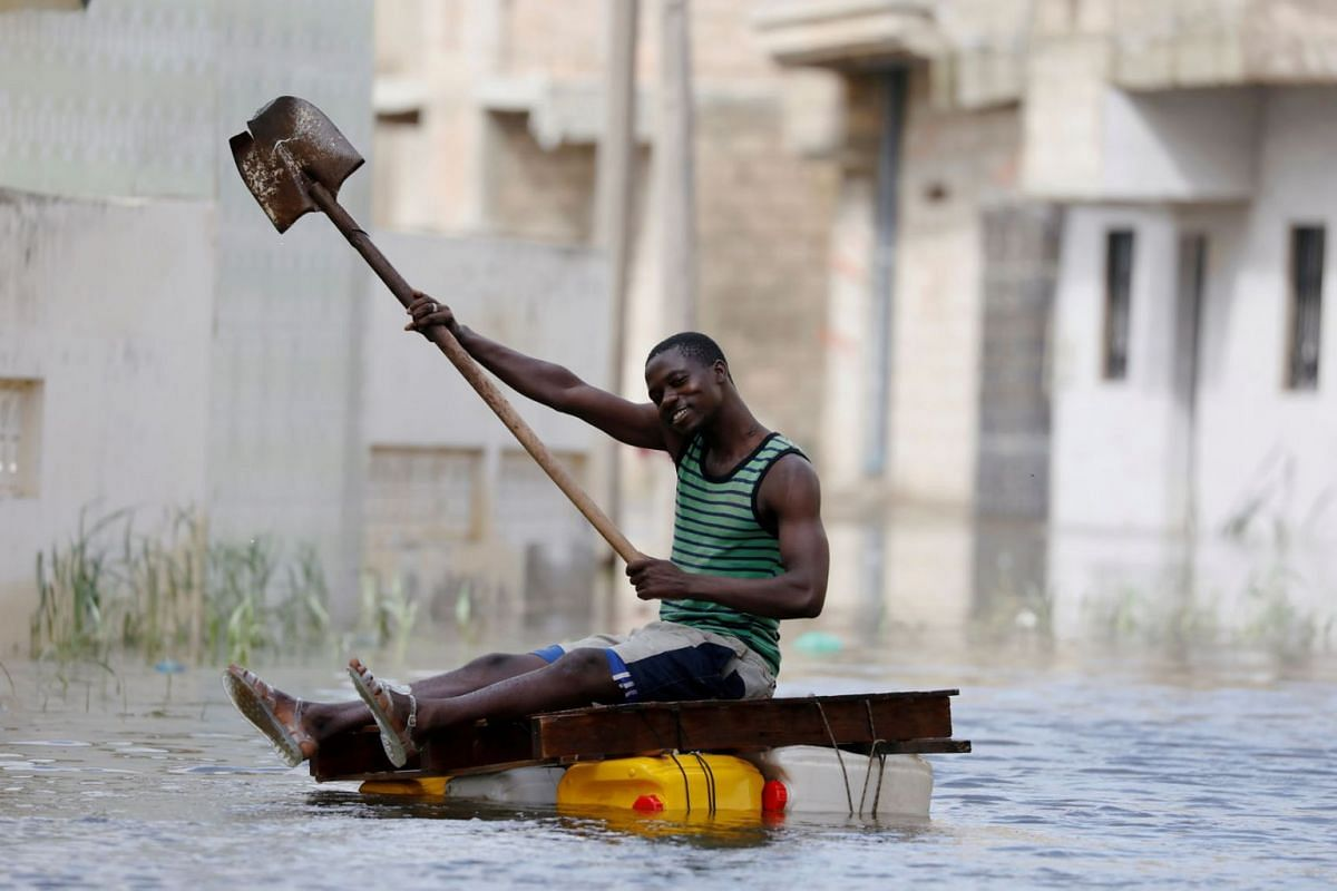 A resident shows his shovel that he uses to row through flooded streets after last week's heavy rains in Keur Massar, Senegal September 8, 2020. PHOTO: REUTERS