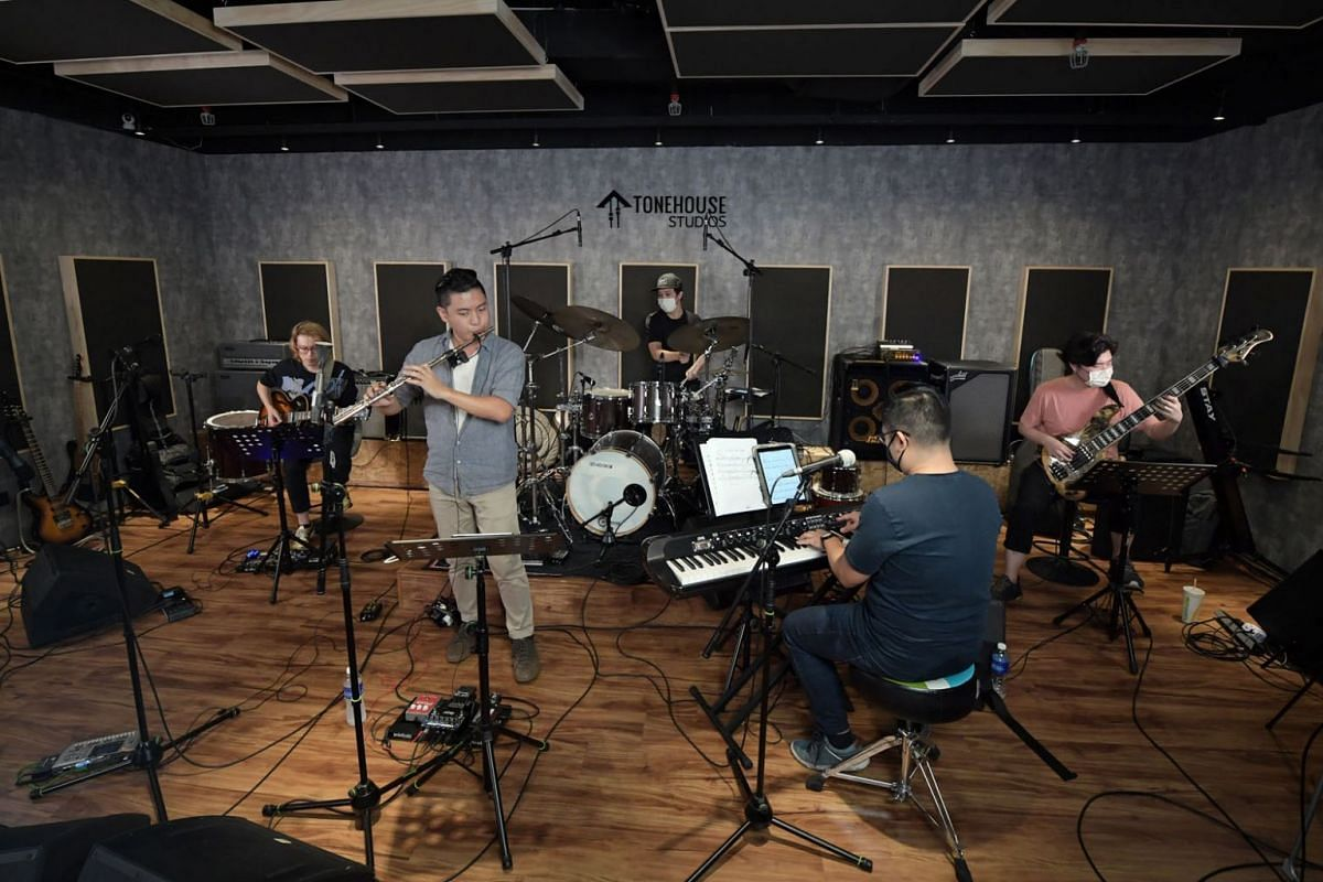 A photo taken on September 6, 2020, shows Local jazz musicians  (from far left) Sebastian Ho, Rit Xu, Teo Jia Rong, Jordan Wei and Ben Poh doing a live-stream performance at music studio Tonehouse. PHOTO: THE STRAITS TIMES/ALPHONSUS CHERN