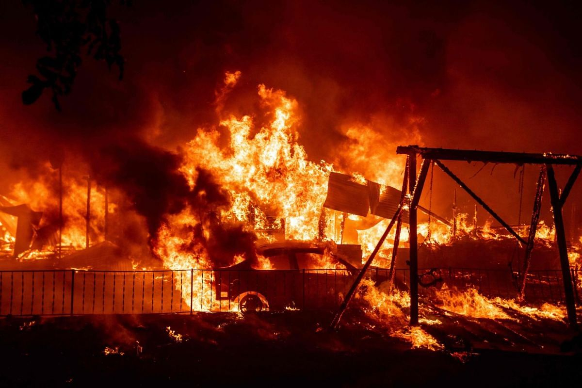 A home burns during the Bear fire, part of the North Lightning Complex fires in the Berry Creek area of unincorporated Butte County, California on Sept 9, 2020.