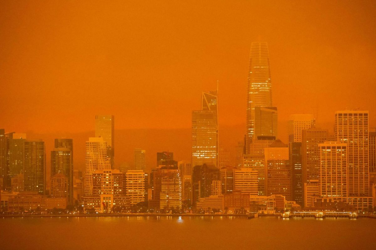 The San Francisco skyline is obscured in orange smoke and haze as seen from Treasure Island in San Francisco, California on Sept 9, 2020.