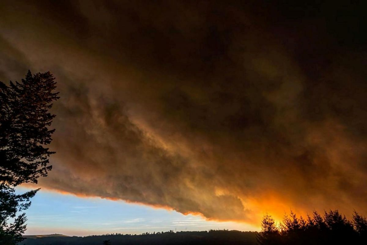 Thick smoke is seen above Salem City, Oregon, US, on Sept 8, 2020, in this picture obtained from social media.