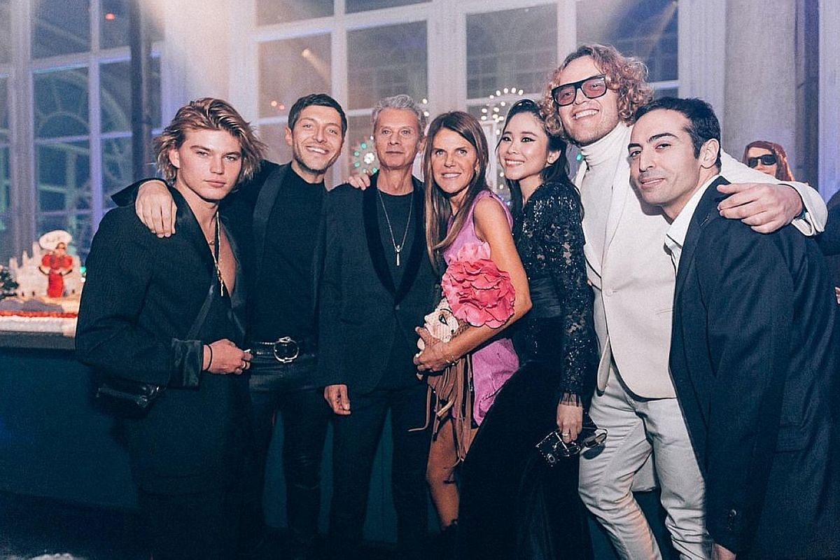 Ms Nga Nguyen (fifth from left) with (from left) model Jordan Barrett, actor Evangelo Bousis, businessman Angelo Gioia, fashion editor Anna Dello Russo, designer Peter Dundas and film-maker Mohammed Al Turki at a party she co-hosted with Dello Russo