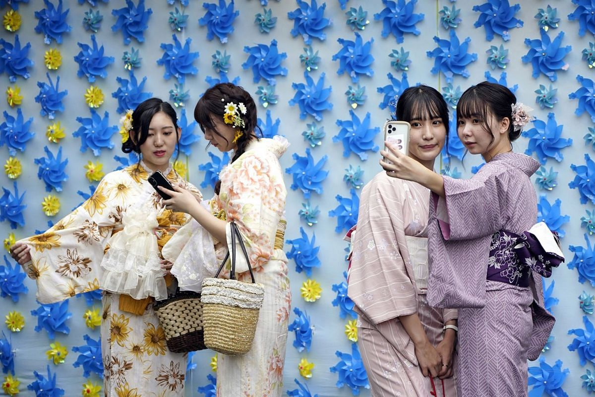 Japanese women wearing 'yukata' casual summer kimono take selfies at Asakusa district in Tokyo, Japan, Sept 13, 2020. Asakusa is one of Tokyo's most-visited areas and is usually crowded with tourists. In Japan, the numbers of visitors from abroad fel