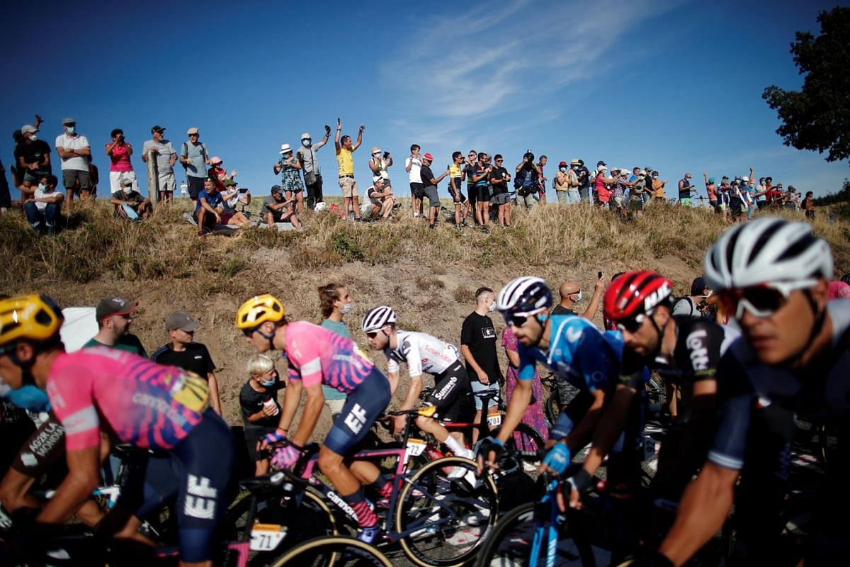 Fans watch the peloton pass during Stage 14 of the Tour de France from Clermont-Ferrand to Lyon, Sept. 12, 2020.