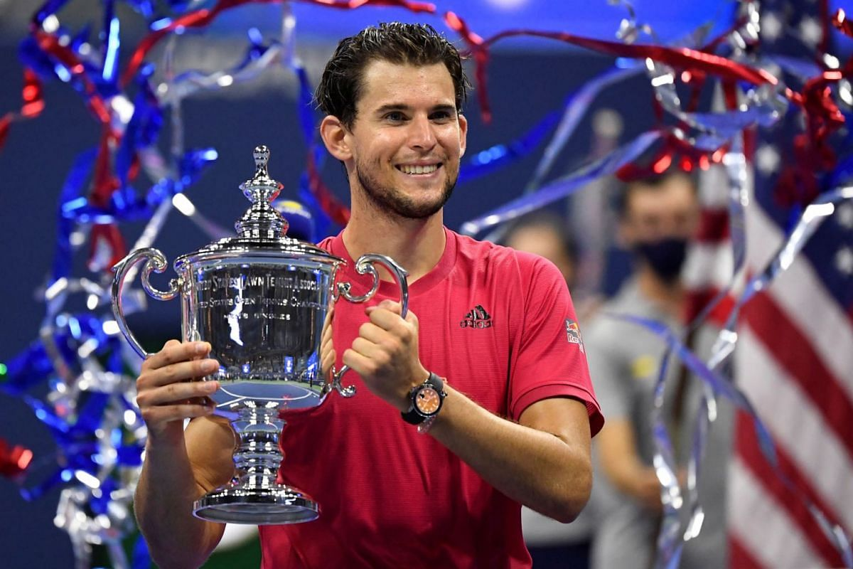 Dominic Thiem of Austria celebrates with the championship trophy after his match against Alexander Zverev of Germany (not pictured) in the men's singles final match on day 14 of the 2020 US Open tennis tournament at USTA Billie Jean King National Ten