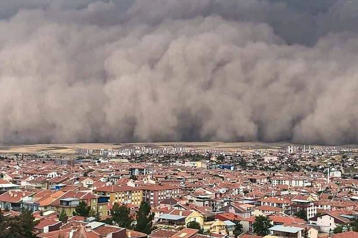 A handout TV screengrab made available by the Demiroren News Agency shows a freak sandstorm sweeping over Polatli, Ankara, Turkey, on September 12, 2020. PHOTO: HANDOUT VIA AFP