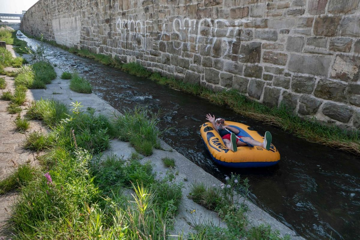 A man enjoys a beautiful sunny day from a rubber boat while rafting the Vienna river (Wienfluss) in Vienna, Austria, on Sept 12, 2020. PHOTO: AFP