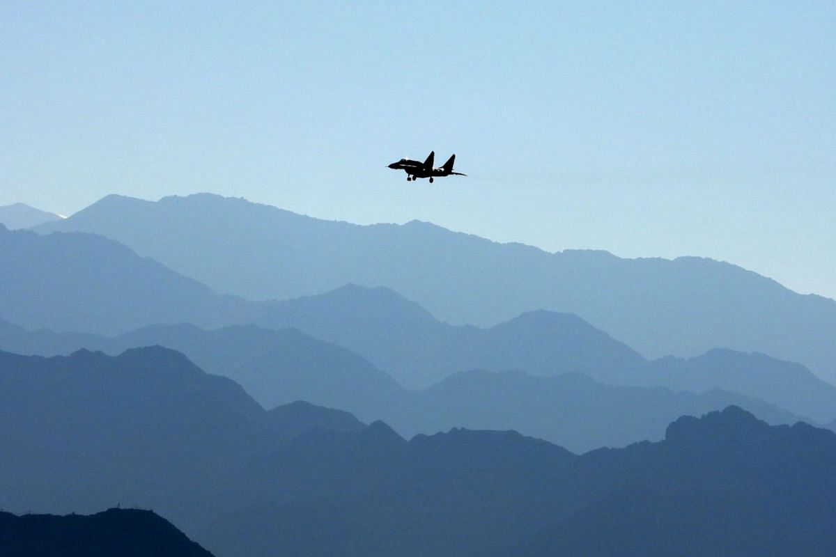 An Indian Air Force fighter jet flies over a mountain range in Leh, the joint capital of the union territory of Ladakh bordering China, on September 15, 2020. PHOTO: AFP