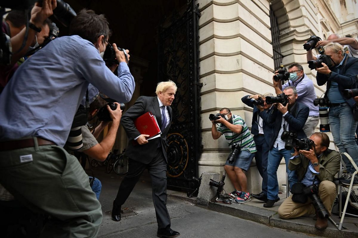 Britain's Prime Minister Boris Johnson returns to Downing Street following a cabinet meeting at the Foreign and Commonwealth office on September 15, 2020.  PHOTO: AFP