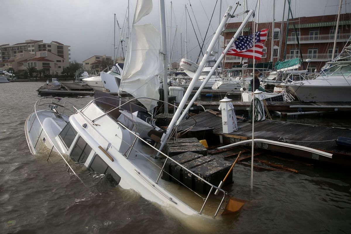 A U.S. flag flies from a boat damaged by Hurricane Sally in Pensacola, Florida, U.S., September 16, 2020. PHOTO: REUTERS