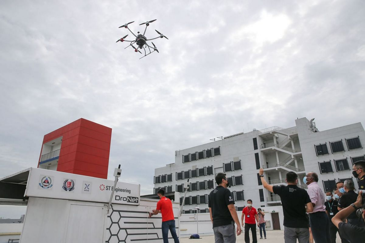 Home Affairs and Law Minister K. Shanmugam watching the drone take off during a flight demonstration at Tuas View Fire Station on September 16, 2020. The machine was developed by the Home Team Science and Technology Agency and ST Engineering Aerospac