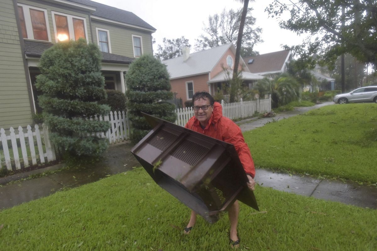 A man surveys storm damage from Hurricane Sally at his home in Pensacola, Florida, on Sept 16, 2020.