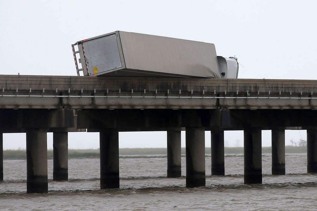 A flipped over trailer is pictured on I-10 East during Hurricane Sally in Mobile, Alabama, on Sept 16, 2020.