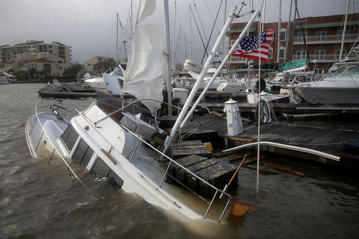 A US flag flies from a boat damaged by Hurricane Sally in Pensacola, Florida, on Sept 16, 2020.