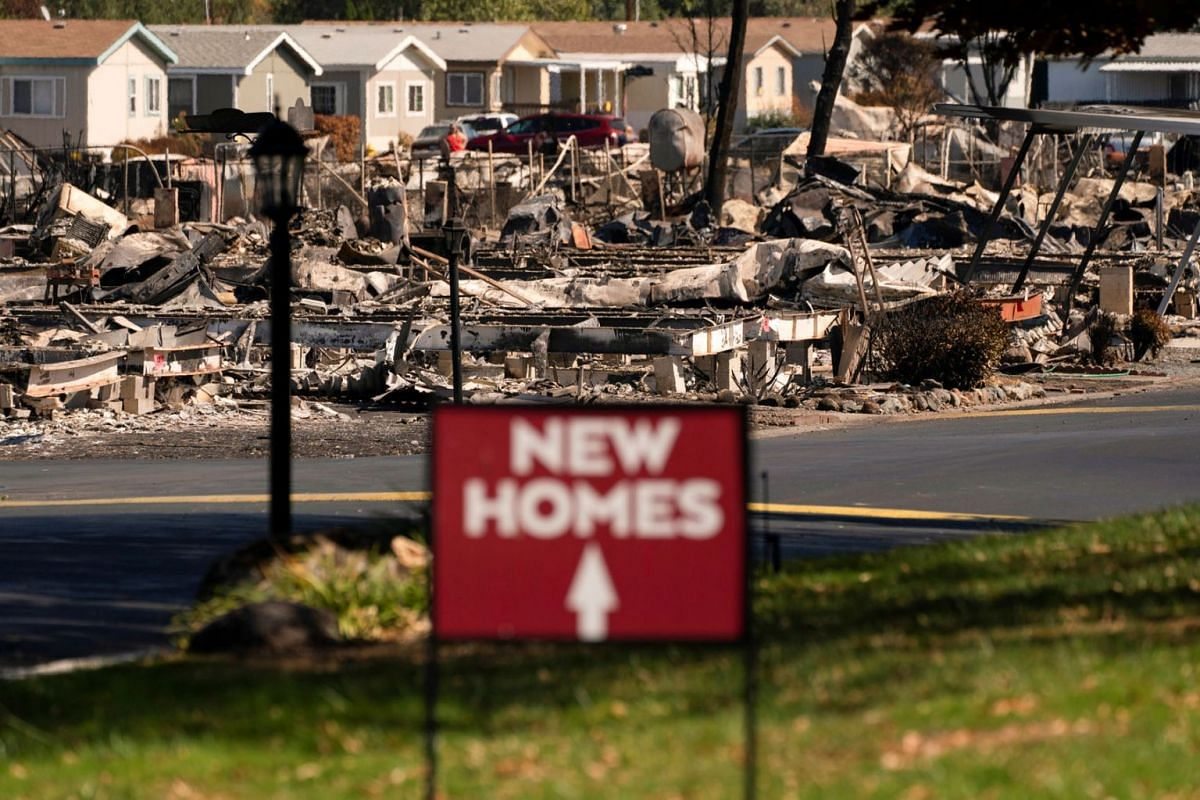 A sign advertising new homes stands in a neighborhood severely damaged by wildfire in Medford, Oregon, U.S. September 20, 2020. PHOTO: REUTERS