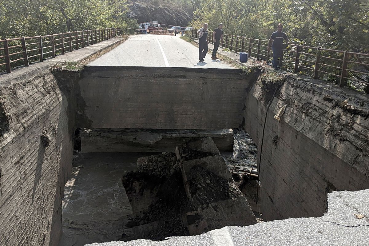 People look at a damaged bridge in Karditsa, central Greece after the floods caused by the Mediterranean hurricane (Medicane) Ianos, in Karditsa, Greece, September 20, 2020. PHOTO: EPA-EFE