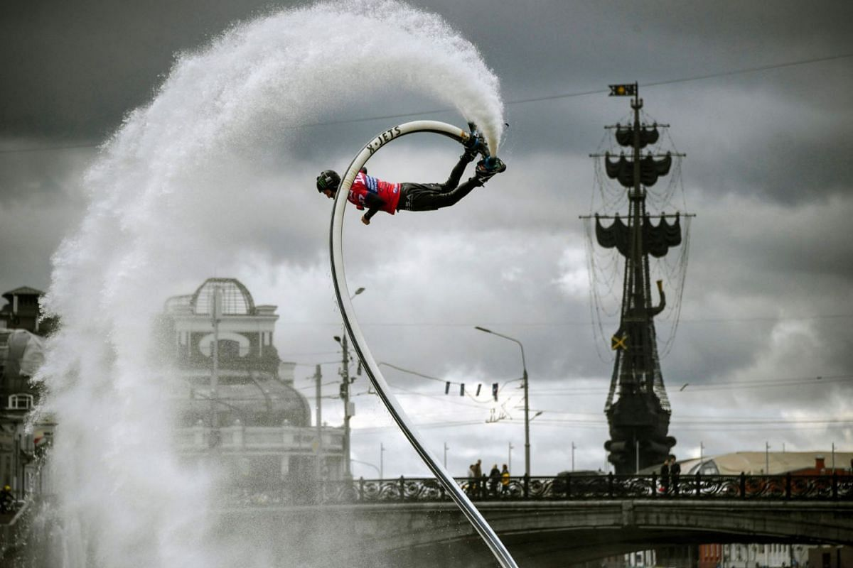 A flyboarder performs in central Moscow on September 19, 2020, during Moscow Water Area festival. PHOTO: AFP