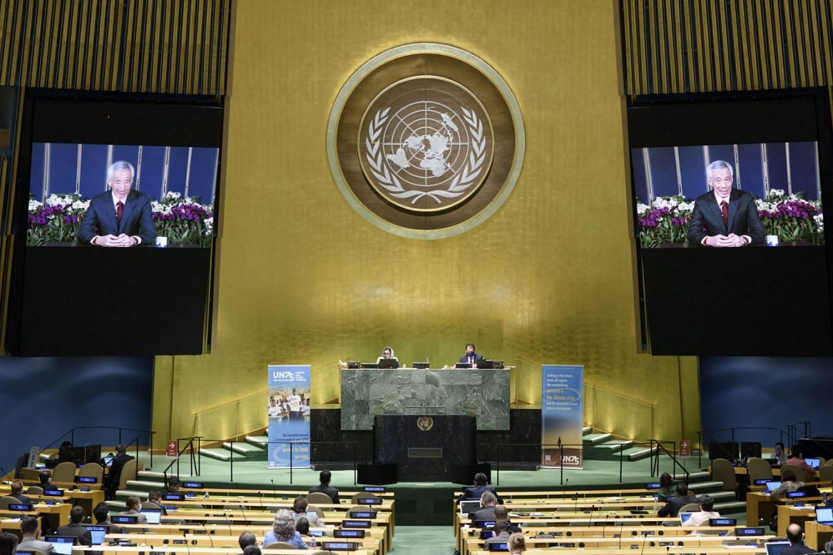 A handout photo made available by UN photo shows Lee Hsien Loong (on screens), Prime Minister of the Republic of Singapore, speaking during the 75th General Assembly of the United Nations, in New York, USA, 21 September 2020. Due to the pandemic, mos