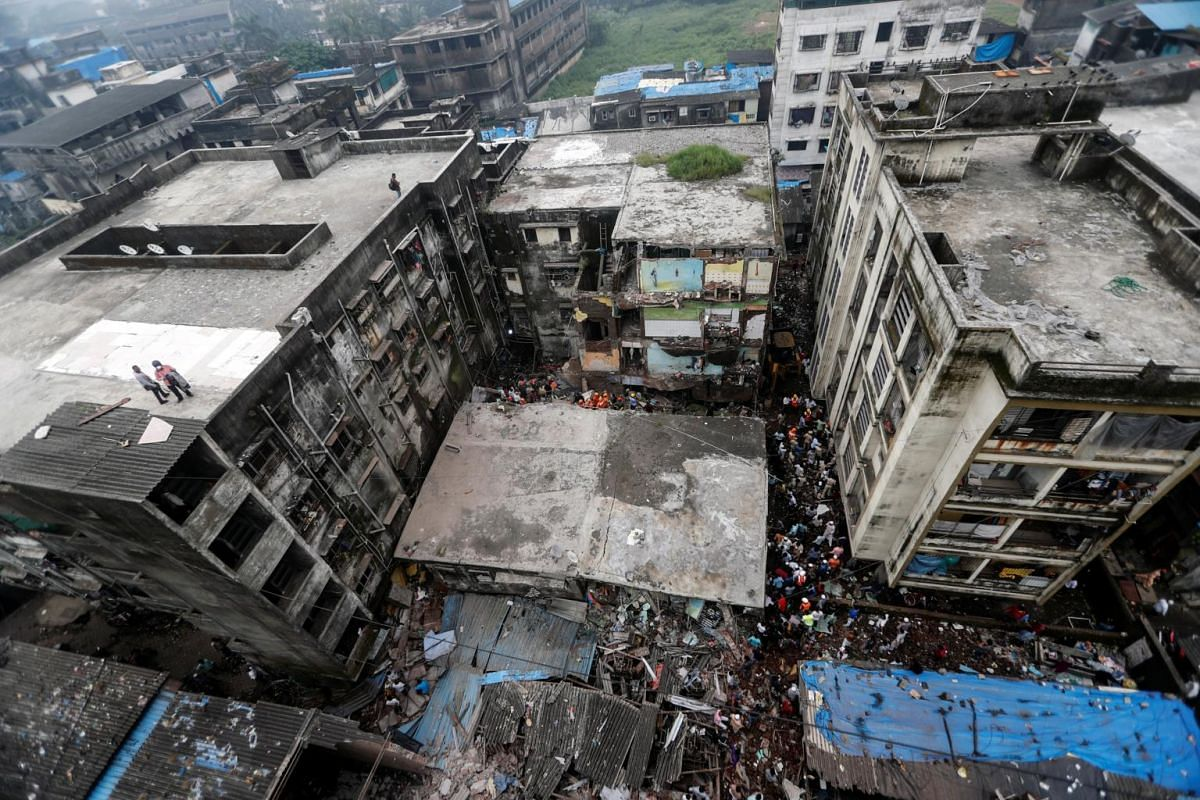 Rescue workers search for survivors amid debris after a three-storey residential building collapsed in Bhiwandi, on the outskirts of Mumbai, on Sept 21, 2020.