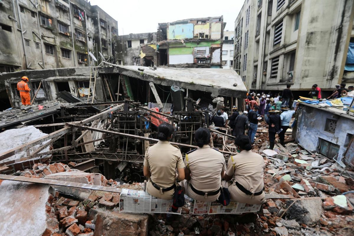 Police officers watch rescue operations after a three-storey building collapsed in Bhiwandi on Sept 21, 2020.