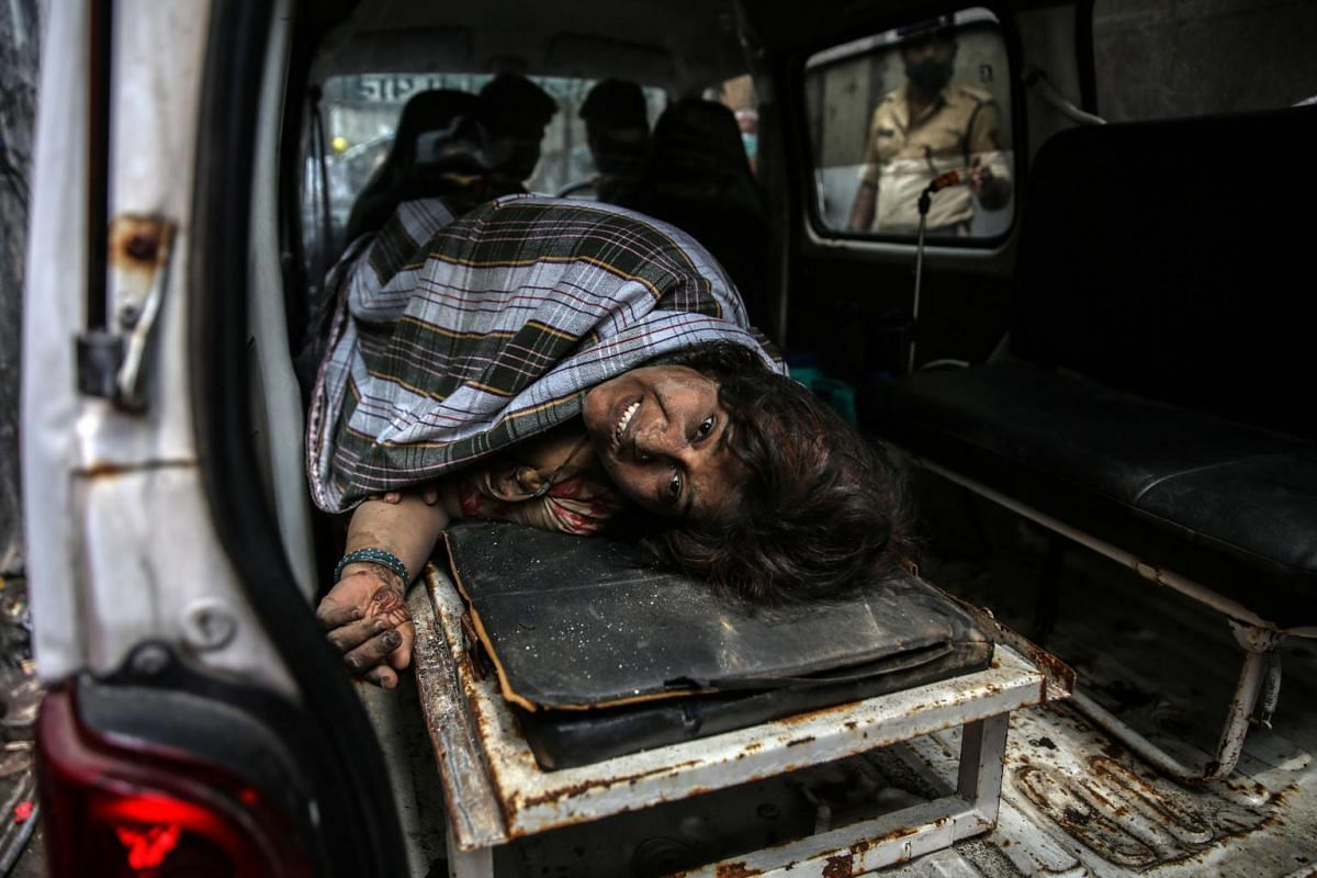 A survivor of a residential building's collapse is seen in an ambulance in Bhiwandi, India, on Sept 21, 2020.